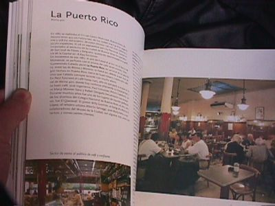 This book is tiled in Spanish as Cafes de Buenos Aires, Coffee Bars in Buenos Aries